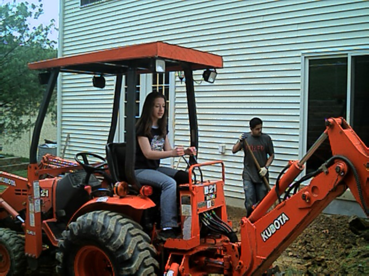 This is my daughter, Danielle trying out her skills as a machine operator ( actually, she was pretty good!!)