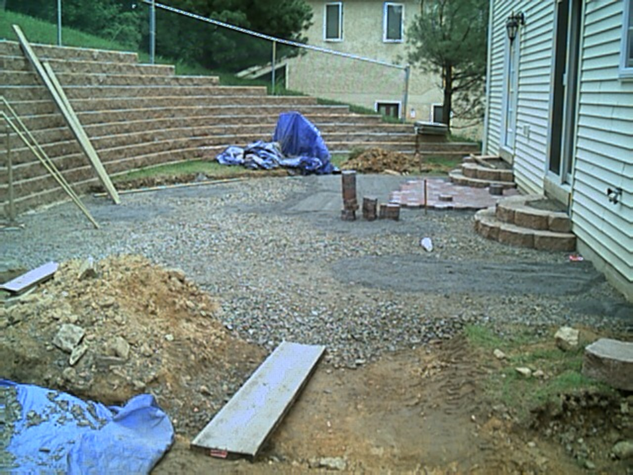 After evenly spreading stone fill, leveling it off, and making the rounded steps we started the pavers.