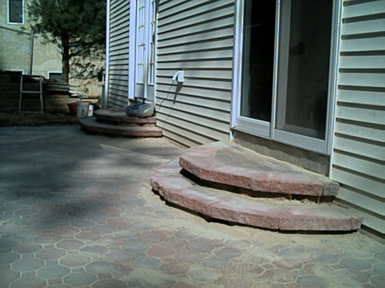 The steps are completely finished by putting the caps on, and the patio is almost done too!