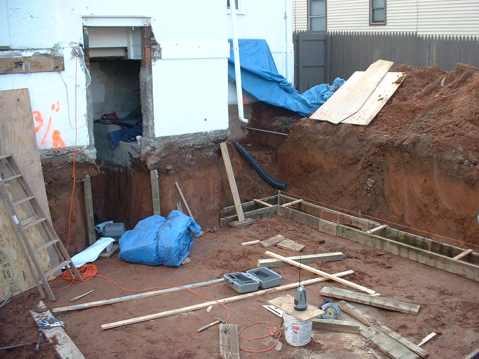 Here you can see the footings are being formed and the existing walls are braced to prevent the house from collapsing.