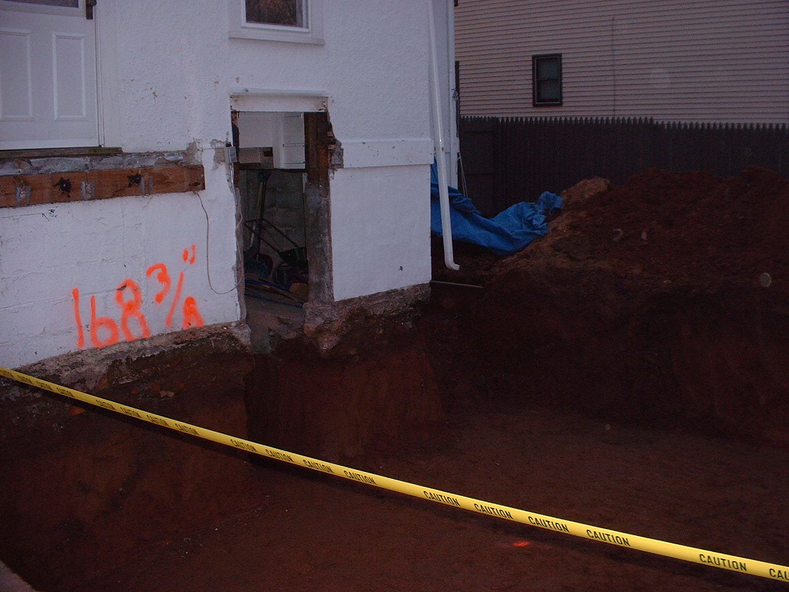 A better picture of the hole. The orange marks you see are the height marks we used to stay level as we dug.