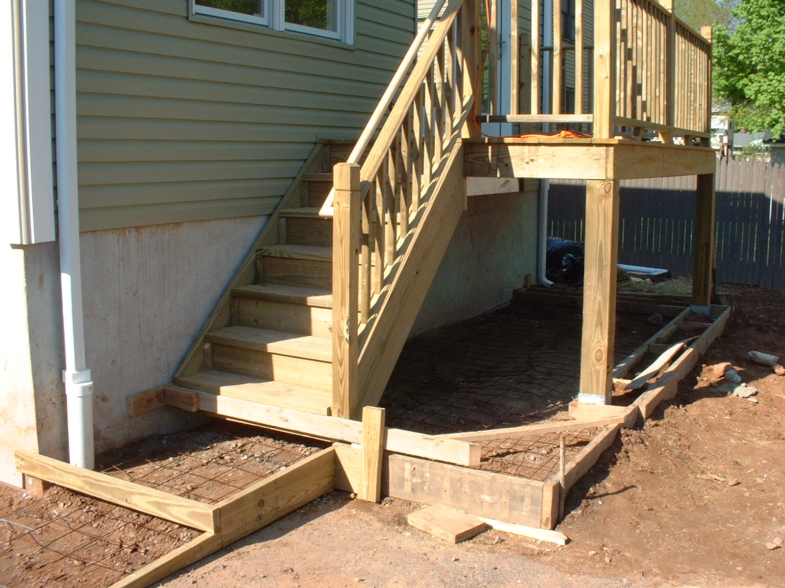 A slab will be poured below the deck to store garbage cans.