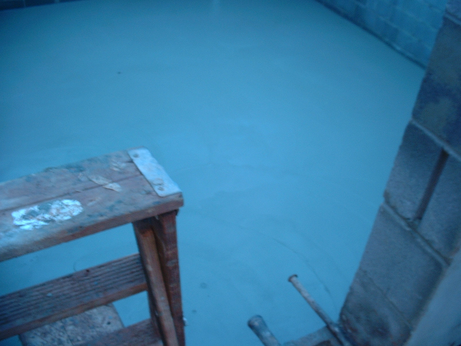 Another picture of the basement floor. The blue color is the tarp.