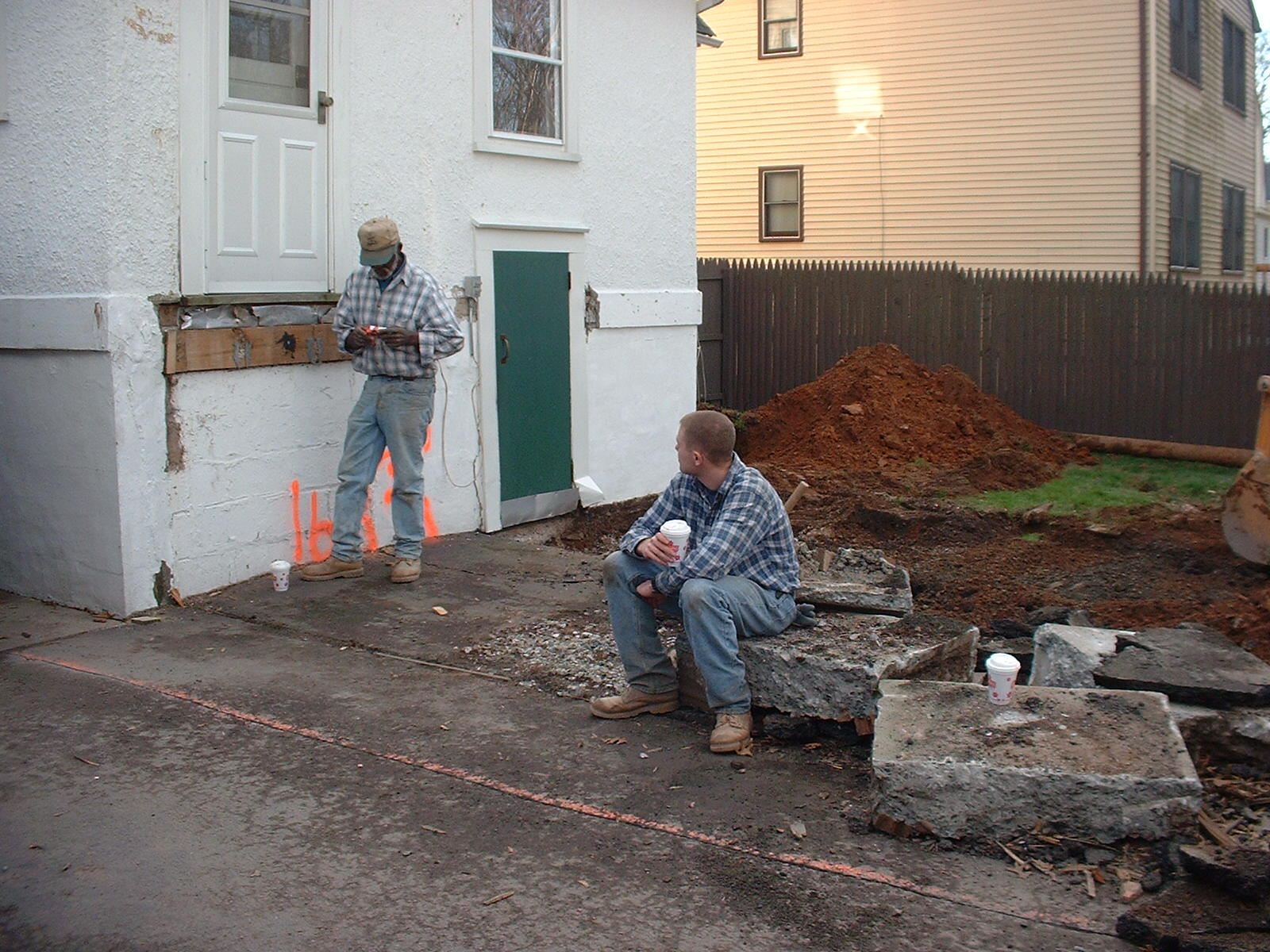 Trevor and Willie taking another break after taking out that giant piece of concrete.
