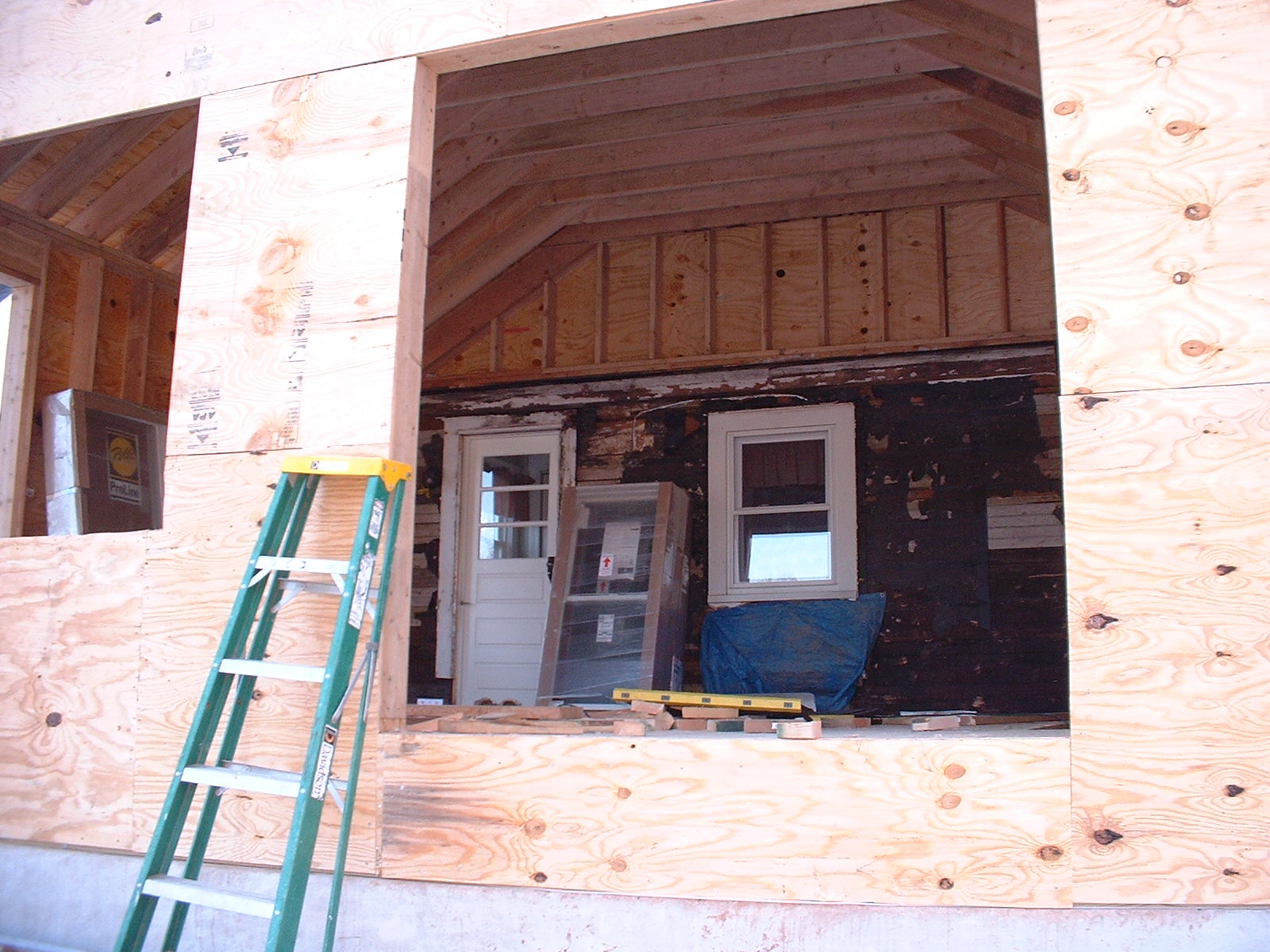 Looking in from the future doorway, you can see the framing inside and the existing wall that will be coming down.