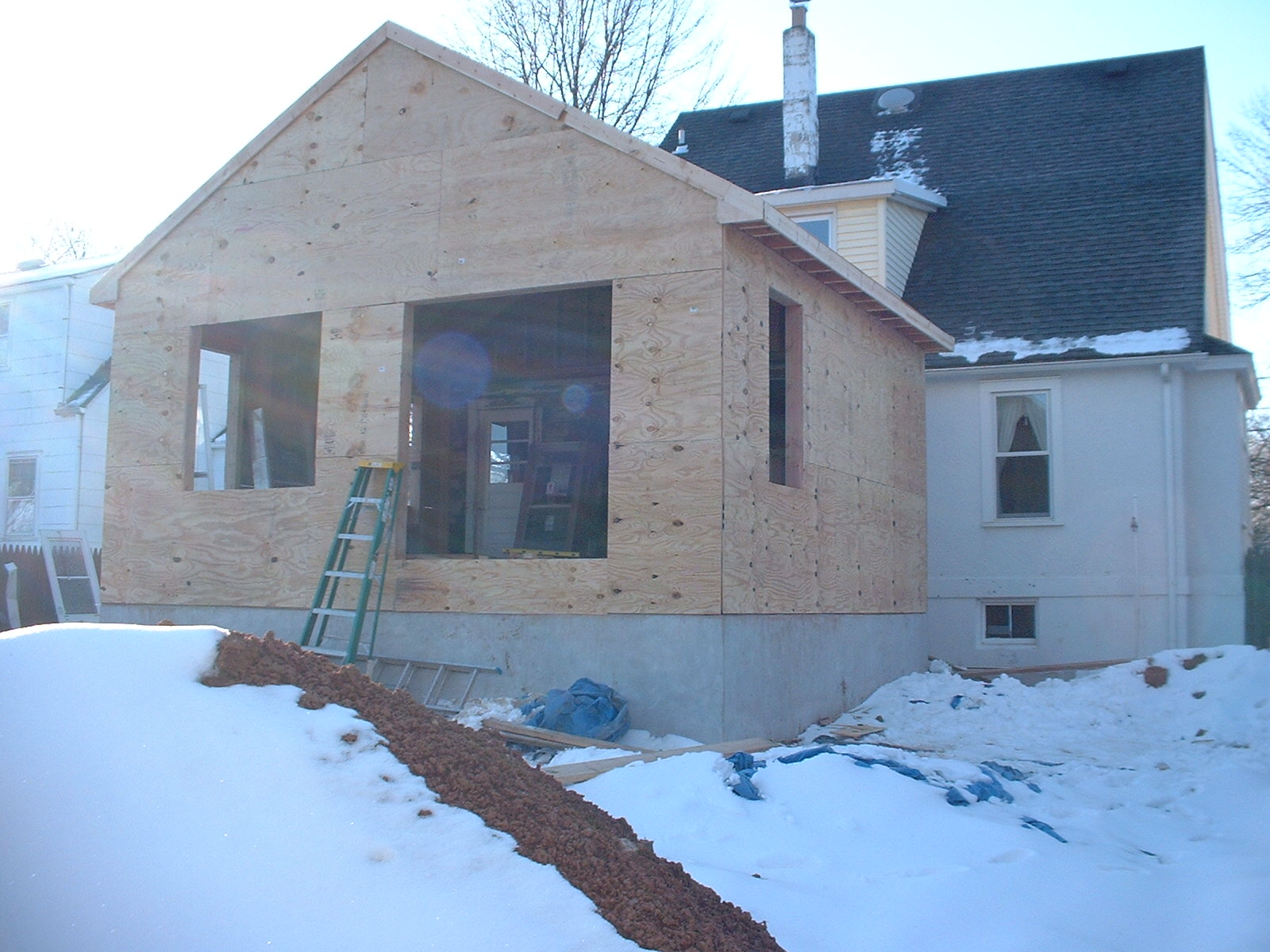 This is a good angle. The large opening in the rear is for a Pella French door.