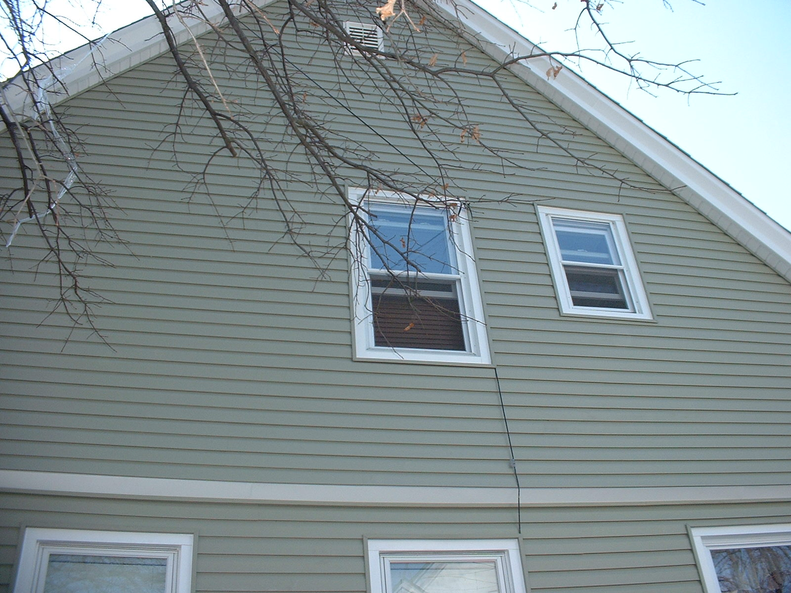 After taking down the existing siding on the gable end, we found old roofing, which had to be removed also.