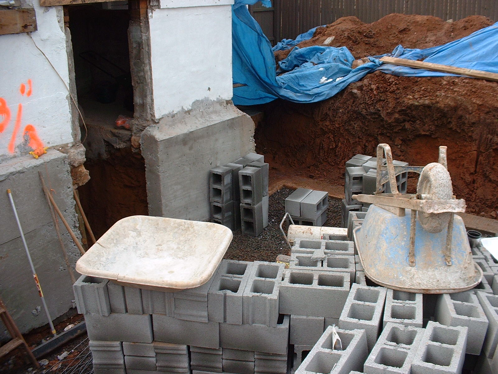 In this picture you can see the concrete is poured to support the existing walls.