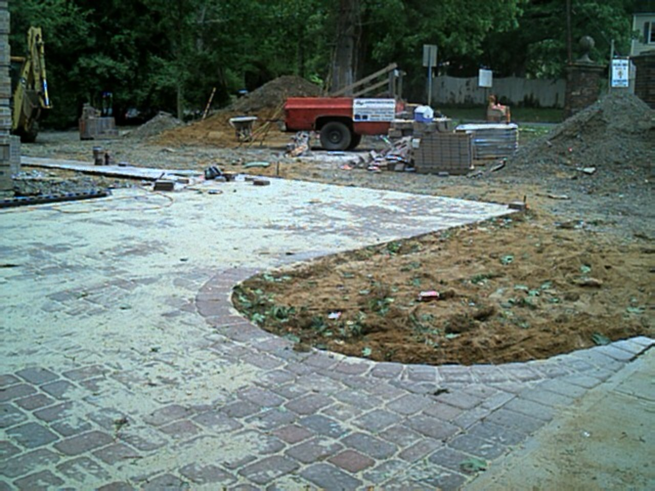 From the main entrance, the brick pavers curve into a parking section