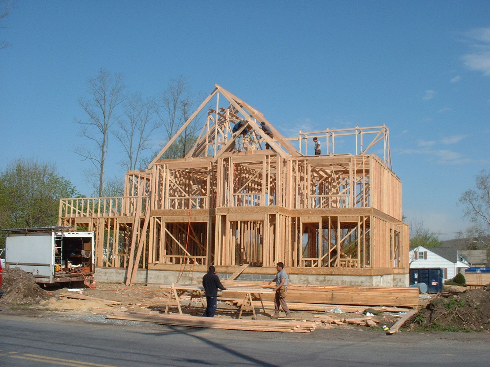 As you can see, the house is almost framed. The framers are working on the roof rafters now.