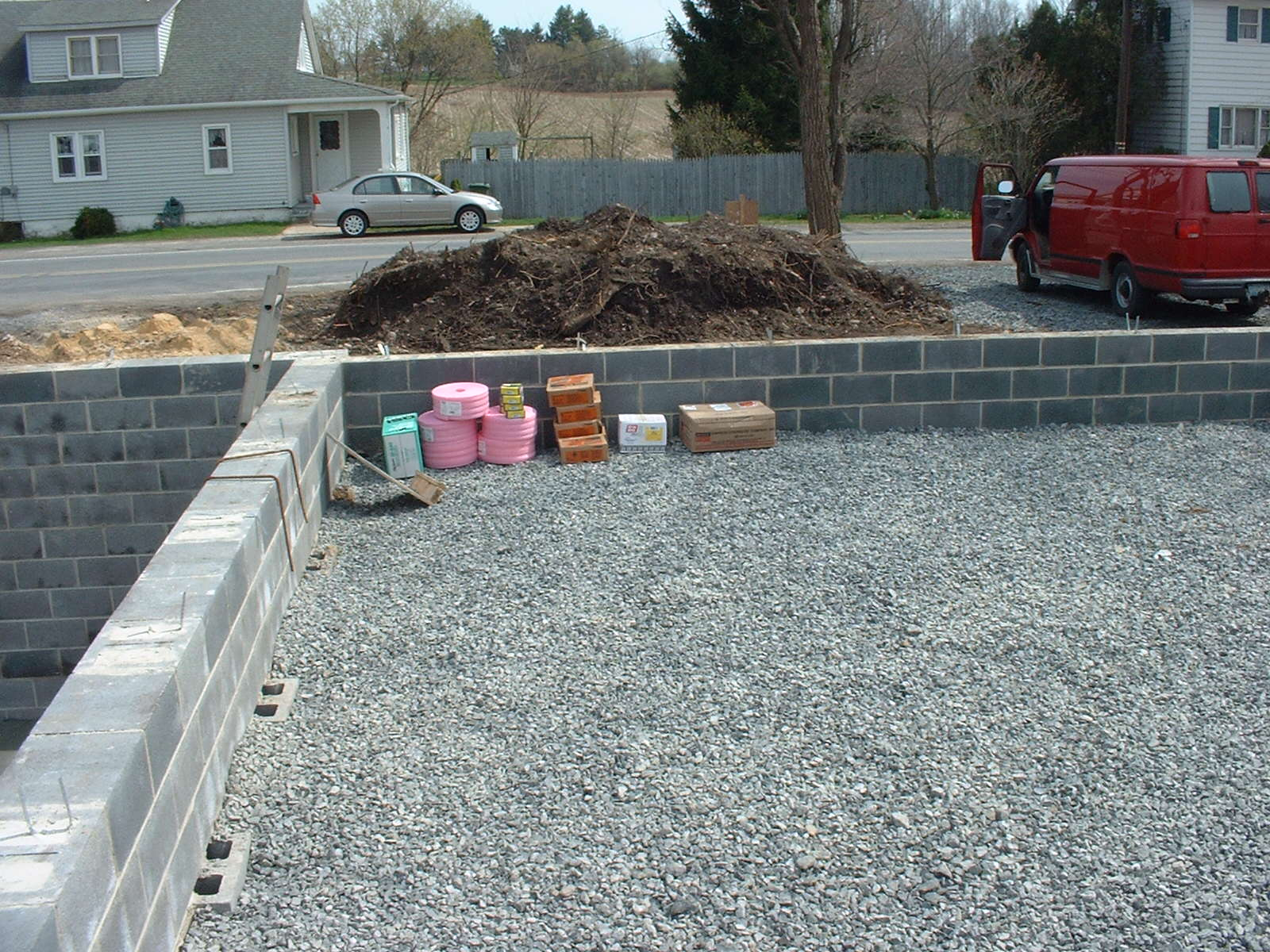 The garage is backfilled and the stone is in place. We will pour the floor after the framing is finished.