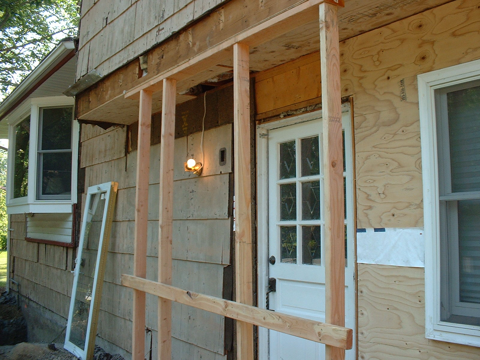The second floor is being braced for the new front door.