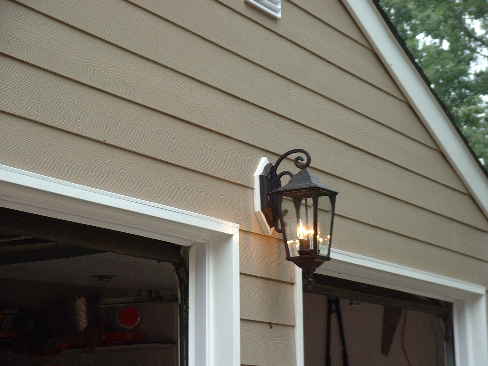 The exterior lights are installed with a custom piece of AZEK.