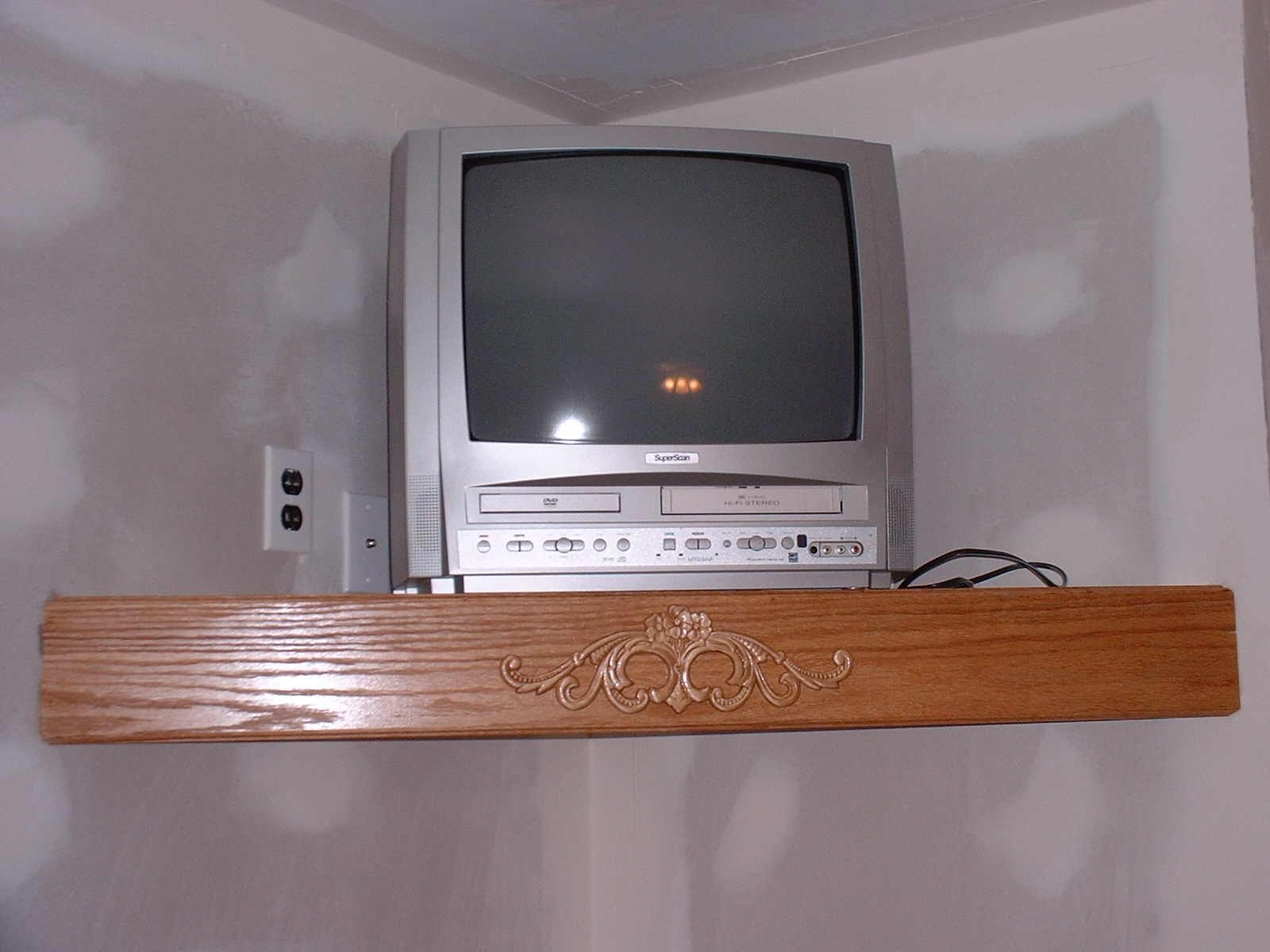 The t.v. sits real nice on this custom oak shelf.