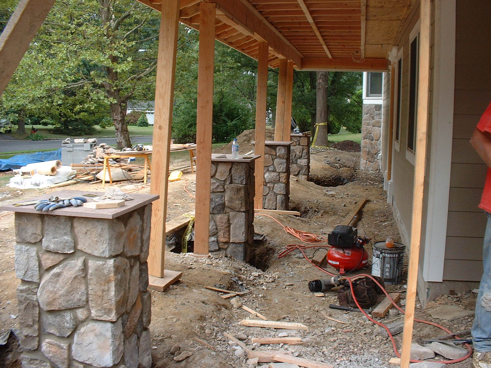 The stone piers are finished and ready to be backfilled.