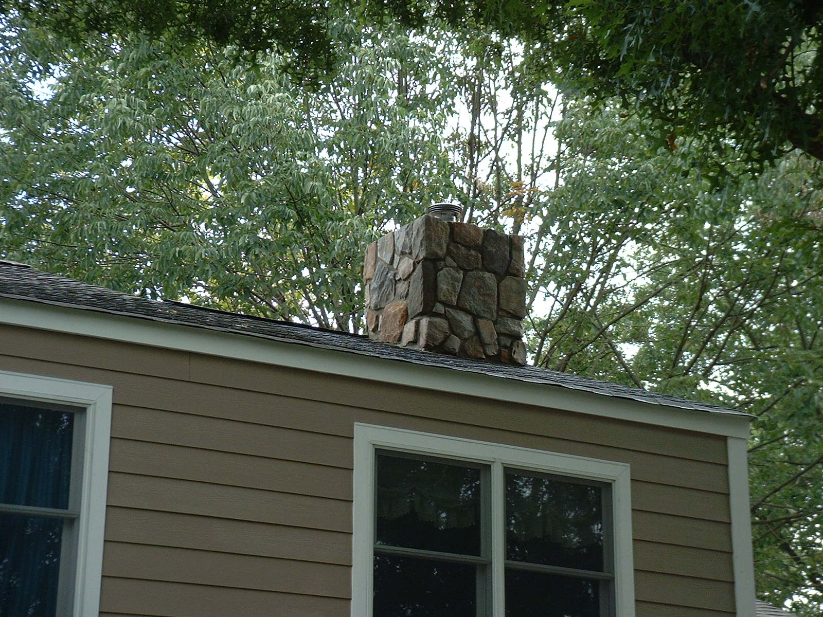 By putting stone on this chimney, it gives the house balance.