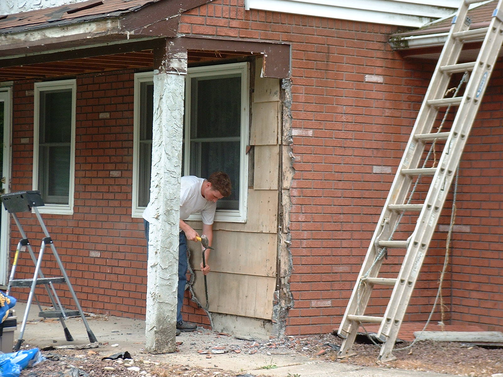 We now have to take off this brickface stucco.