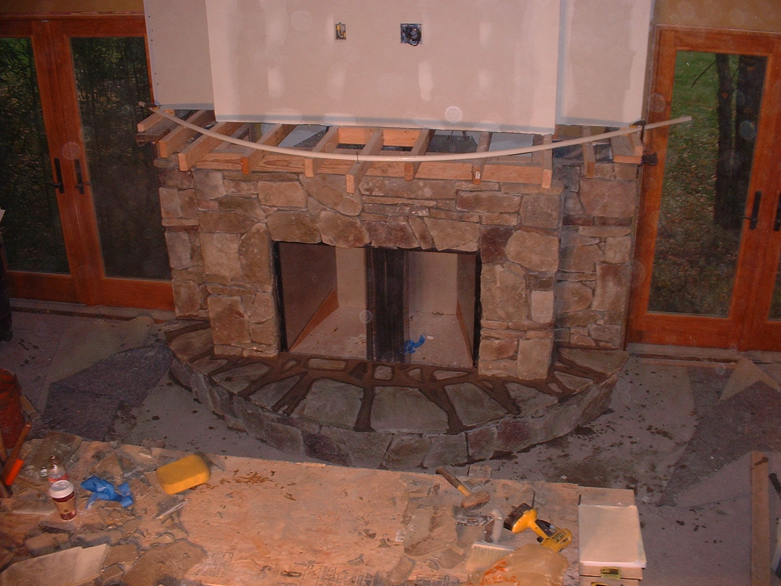 The top of the hearth is done with a natural stone.