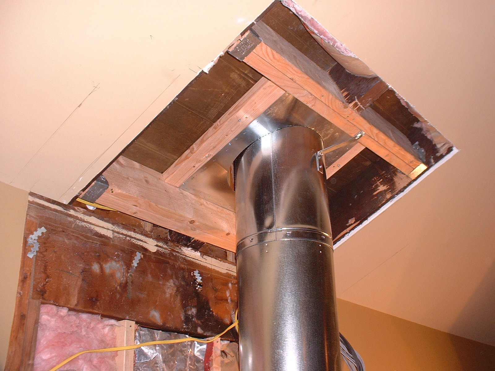 The chimney stack had to go through the cieling and onto the roof.