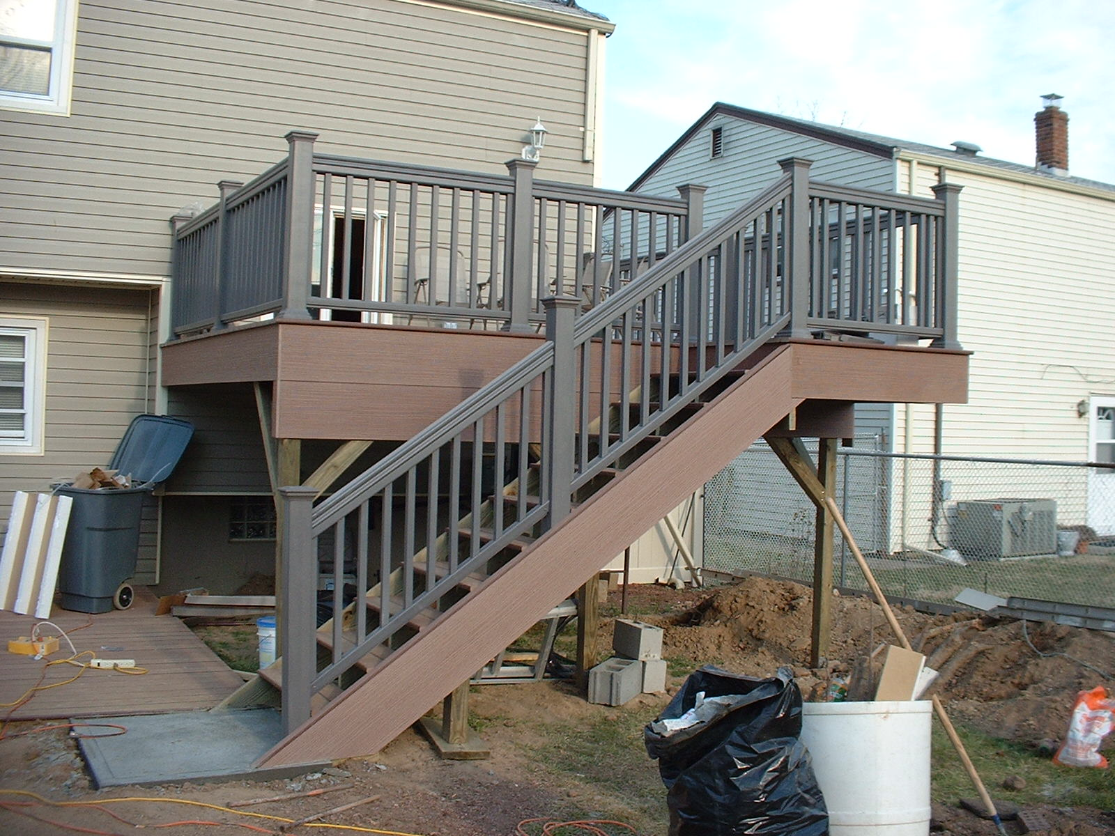 Both decks are now finished and a concrete pad is poured for the bottom of the stairs.