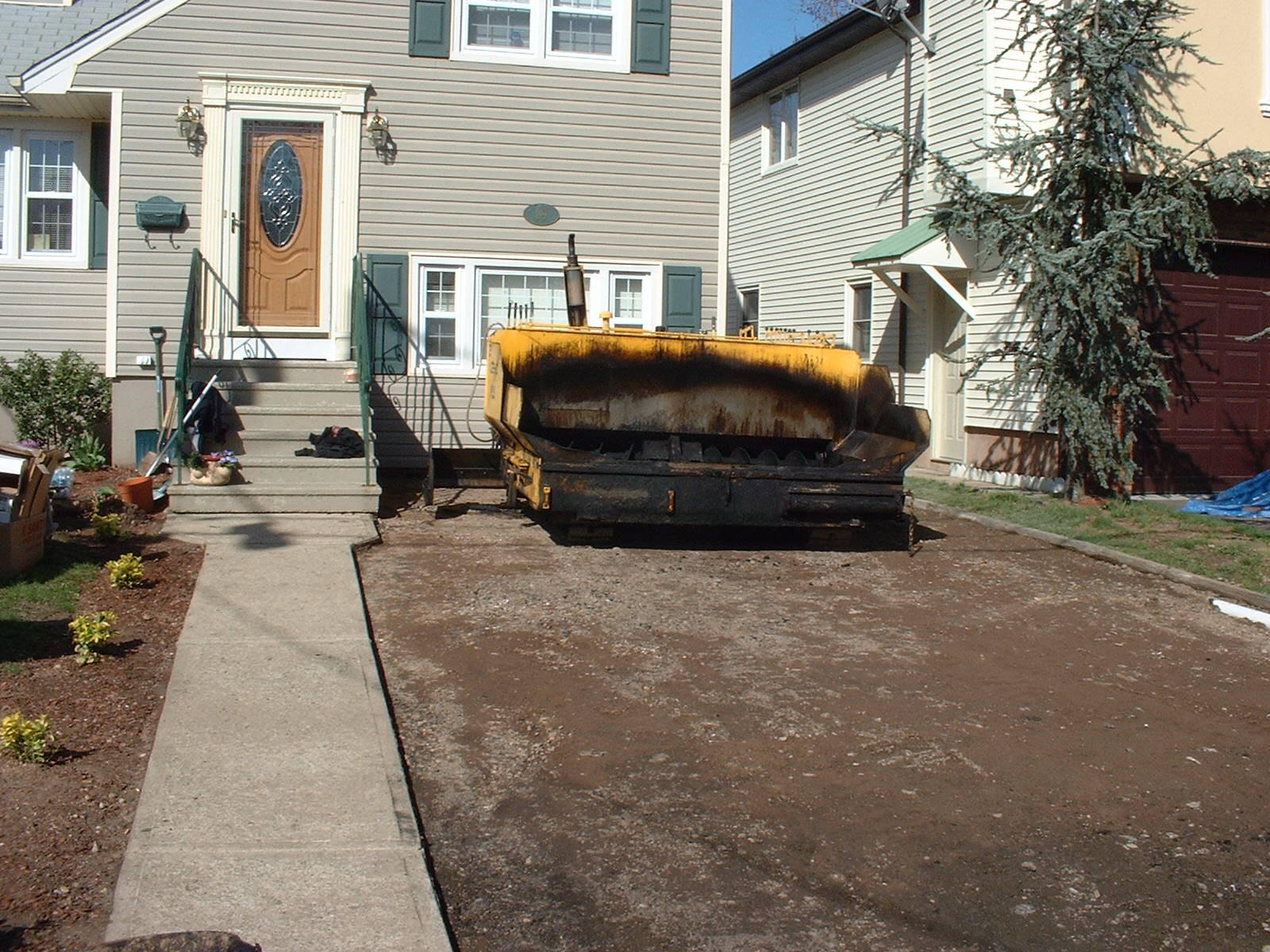 The old driveway is out and the new base has been leveled and compacted.