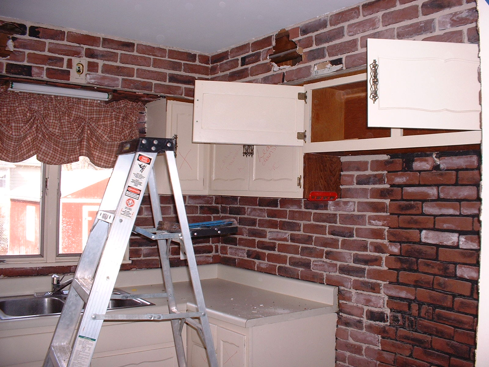 We have started to take the old cabinets down. Nice brick...huh?