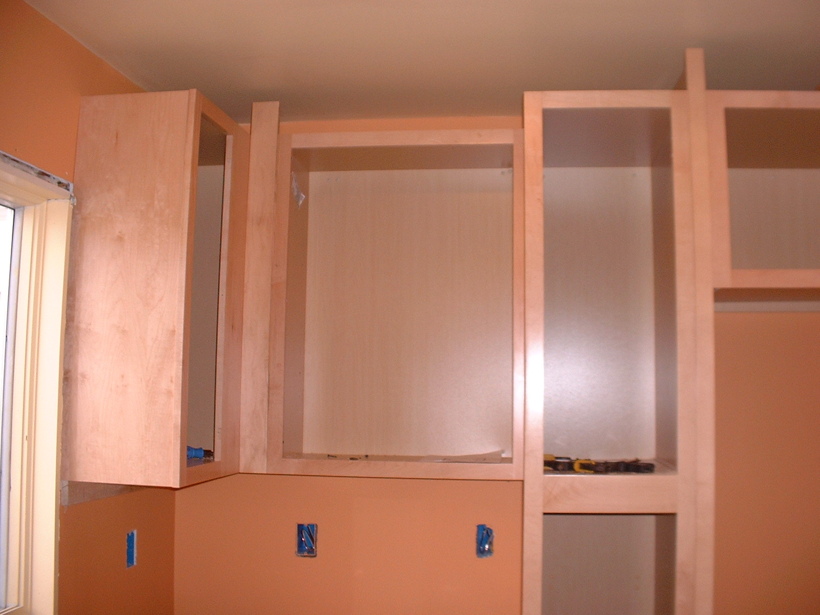 The upper cabinets are almost finished.