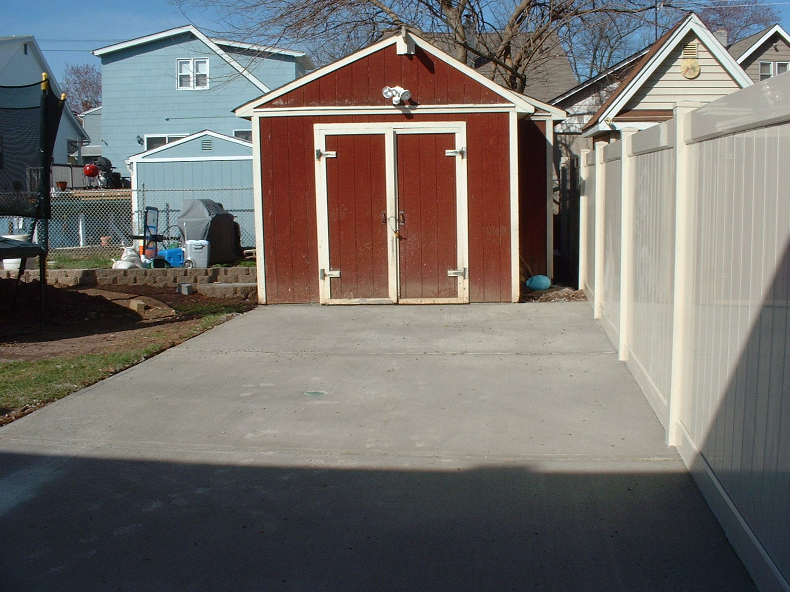 We also installed a spot light on the shed in the back yard to give light to this beautiful concrete patio.
