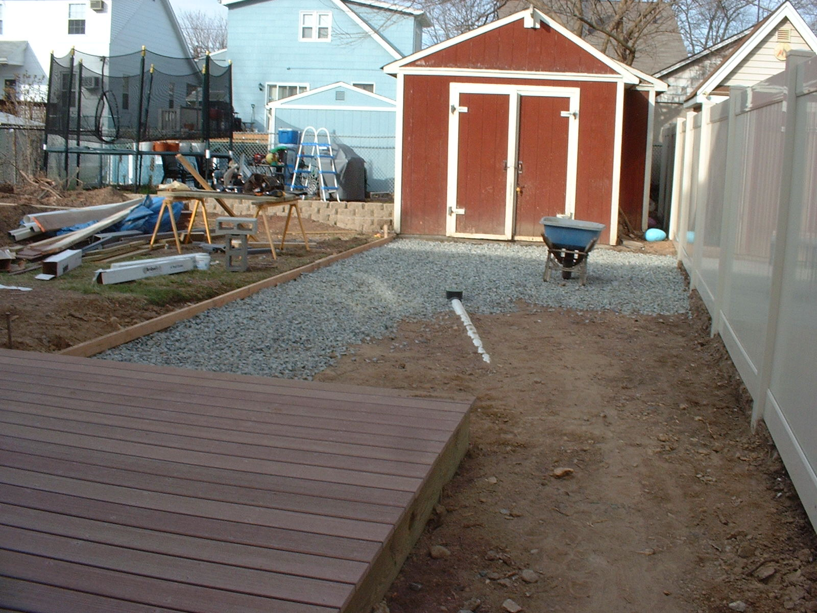 The lower deck is complete and we have started to put stone in for the patio base.