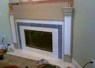 We are putting the custom surround and mantle on the fireplace.