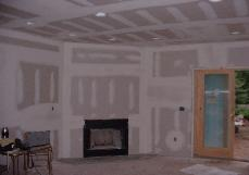 Sheetrock is now finished, the spackle process is important for nice smooth walls.