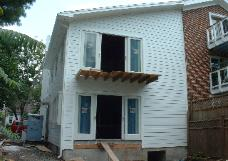 Siding and trim is finished, and we'll be working on the Master Bedroom balcony soon.