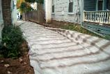 A heavy duty filter fabric is used in the driveway, to prevent soft spots.
