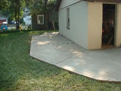 The Owner wanted the patio to go around the attached Garage.