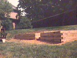We built this railroad tie retaining wall with steps going up into the back yard in Bridgewater, NJ.