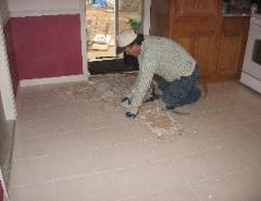 Here I am with an air hammer, taking out the ceramic tile floor.