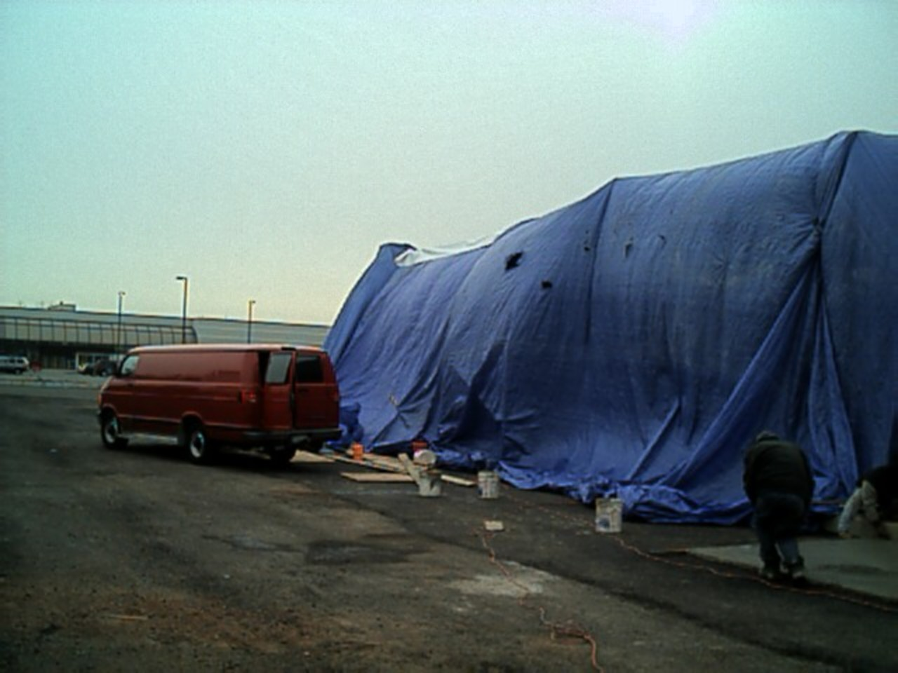 Another view of how massive the tarped area is, and my Dodge van got in this picture too!.