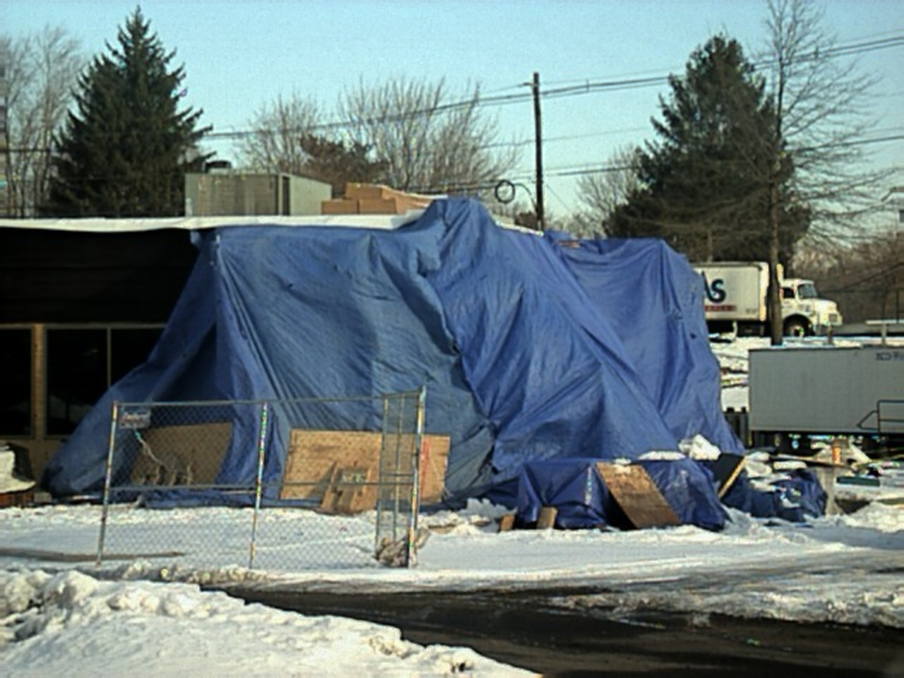 Another view of how the wind sucks the tarps close to the scaffold. It's like being in a giant blue lung.